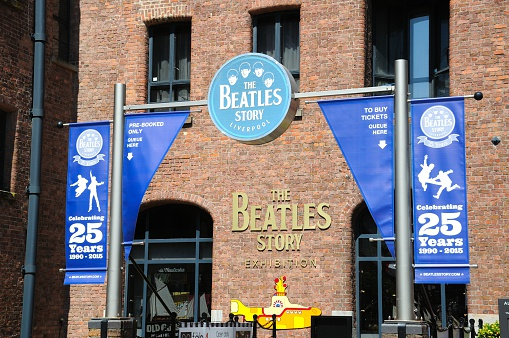 Liverpool, United Kingdom - June 11, 2015: Entrance to The Beatles Story building at Albert Dock, Liverpool, Merseyside, England, UK, Western Europe.