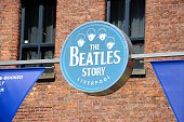 Liverpool, United Kingdom - June 11, 2015: Sign on the outside of The Beatles Story building at Albert Dock, Liverpool, Merseyside, England, UK, Western Europe.