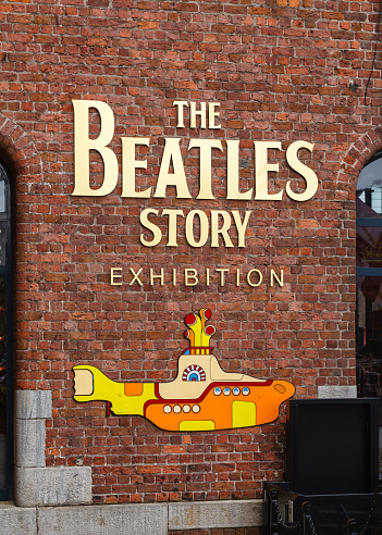 Liverpool, England - May 25, 2015:  The entrance to the The Beatles Story.  The exhibition at The Albert Dock in Liverpool is dedicated to the 1960s rock band The Beatles.