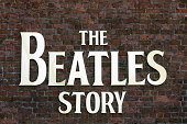 Liverpool, UK - July 11, 2014: View of the The Beatles Story Sign at the Albert Dock, Liverpool.  There are no people in the photograph.