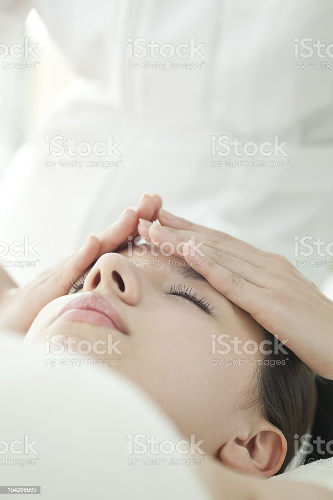The beautician who massages a face stock photo
