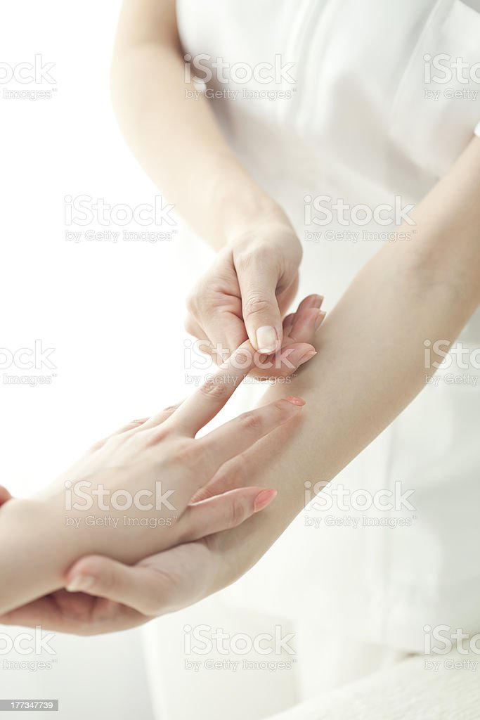 The beautician who massages a finger stock photo