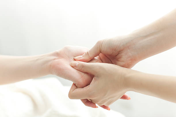 The beautician who massages a hand stock photo