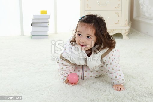 956002732 istock photo the beautife little girl in the pink bule pyjamas played in the room 1042942734