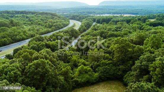 The beautiful aerial remote view to Delaware Water Gap and the border with Pennsylvania from New Jersey, over the hills of Appalachian mountains and Christopher Columbus Highway. Elevated drone point of view. The hot summer day.