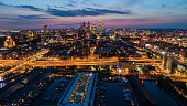 Philadelpia Downtown at sunset. The view from the Benjamin Franklin Bridge over the piers in Old City and Delaware River. Pennsylvania, USA.