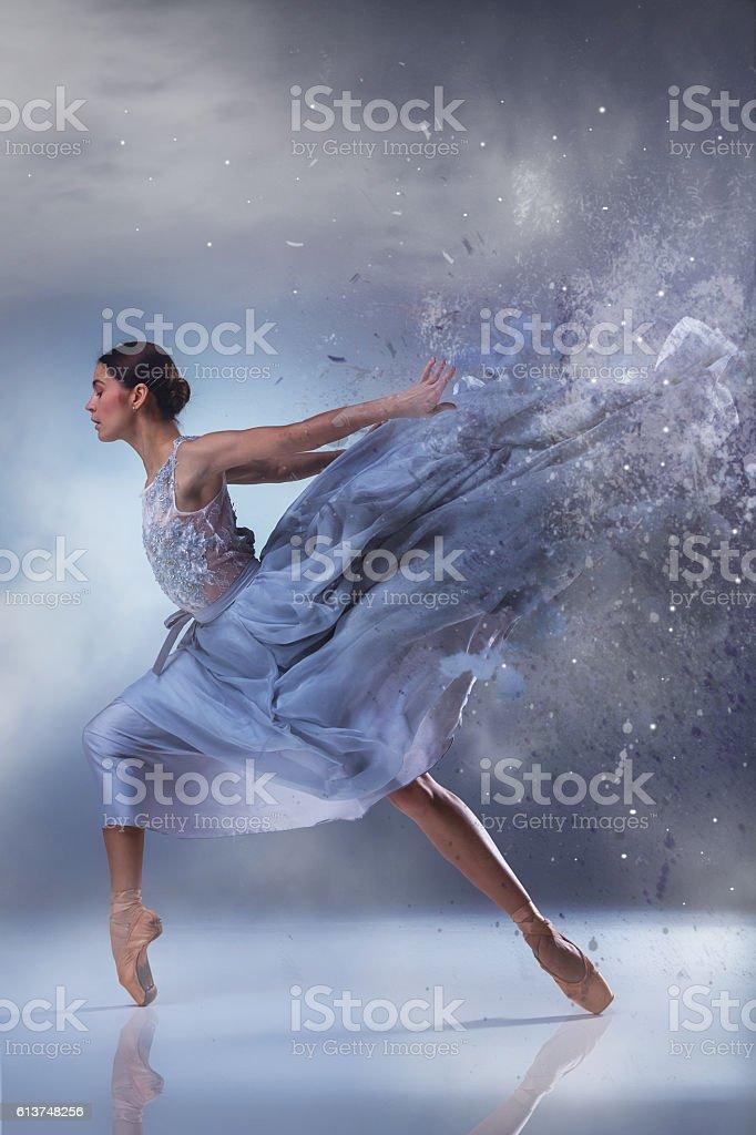 The beautiful ballerina dancing in blue long dress stock photo