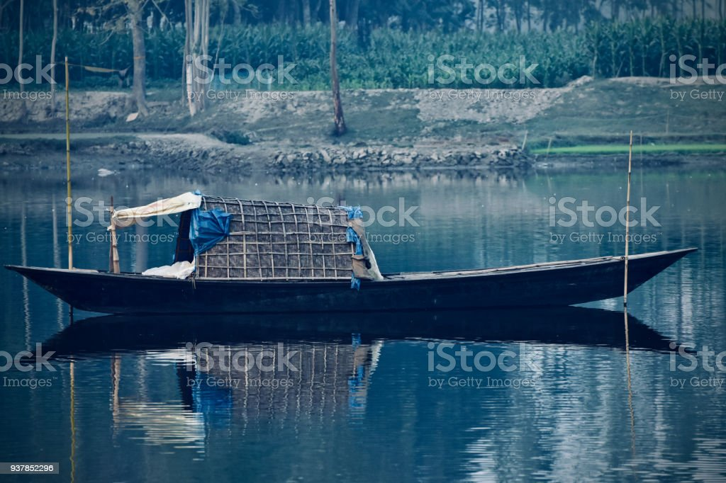 The beautiful black boat on the river water stock photo