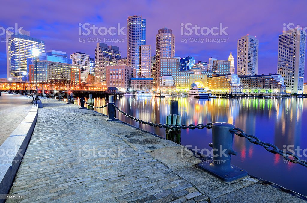 The beautiful Boston Harbor Skyline at night stock photo