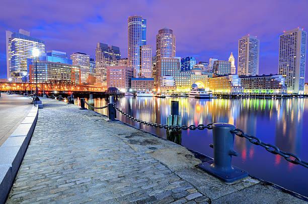 The beautiful Boston Harbor Skyline at night stock photo