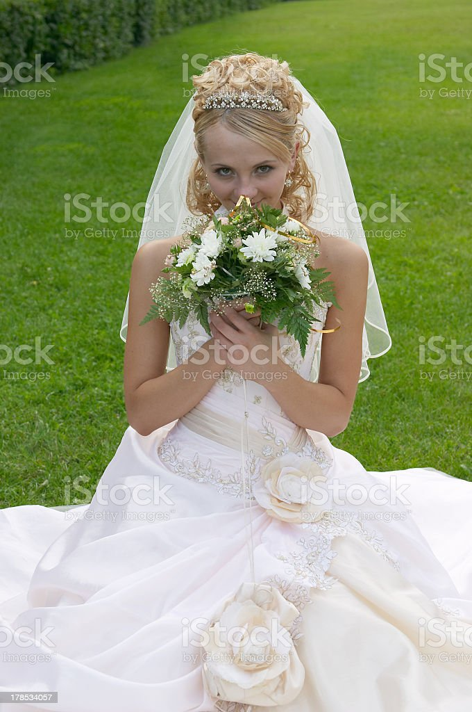 The beautiful bride with a bouquet of flowers. stock photo