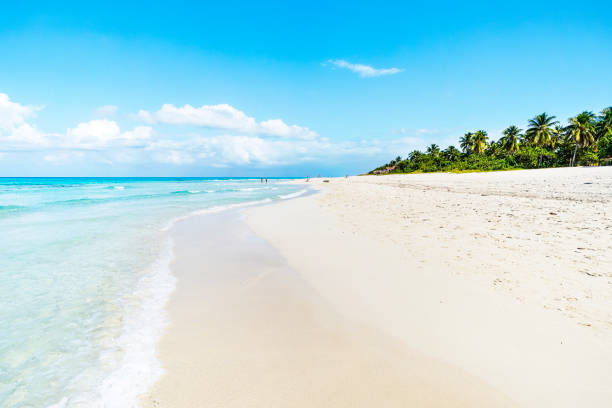 The beautiful cuban beach of Varadero with sailing boats, white sand and cristal turquoise water stock photo