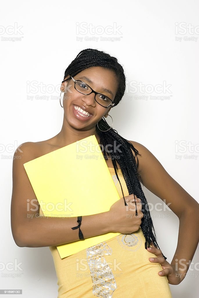 The beautiful Dominican student with a writing-book in hand royalty-free stock photo