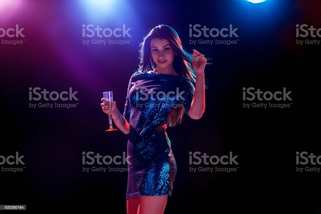 The beautiful girl dancing at the party drinking champagne royalty-free stock photo