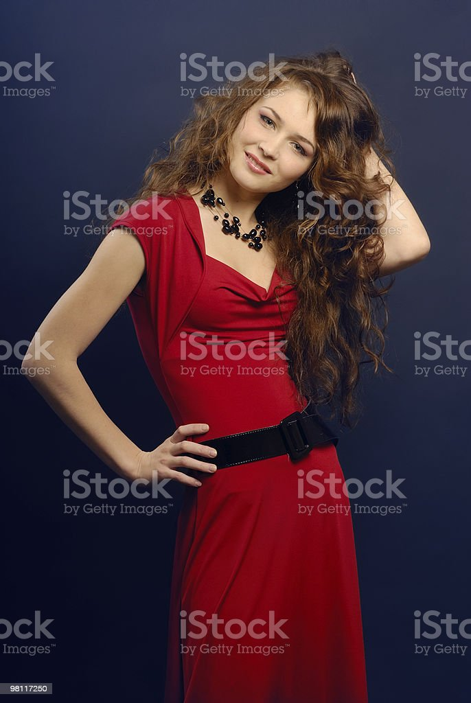 The beautiful girl in a red dress royalty-free stock photo