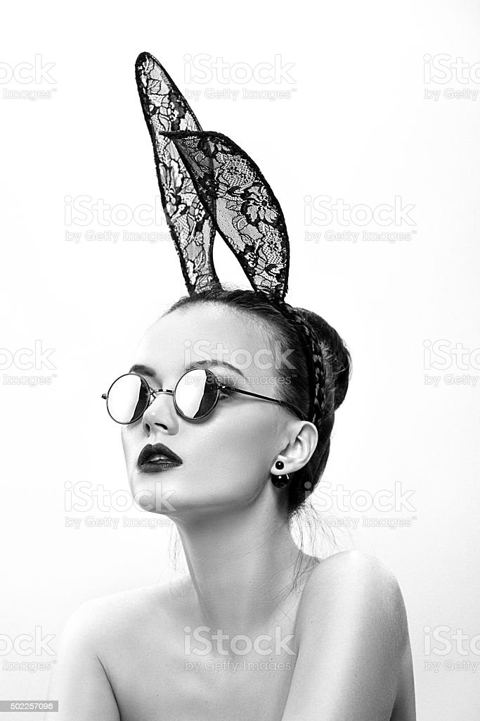 The beautiful girl model in an image of a rabbit stock photo