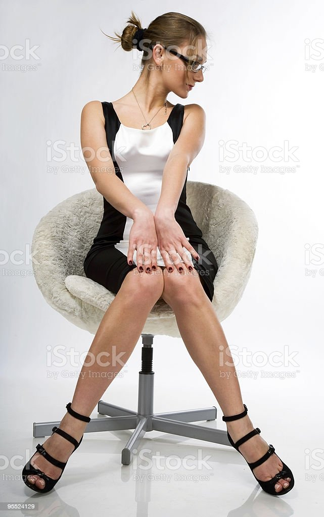 the beautiful girl sitting on a chair royalty-free stock photo