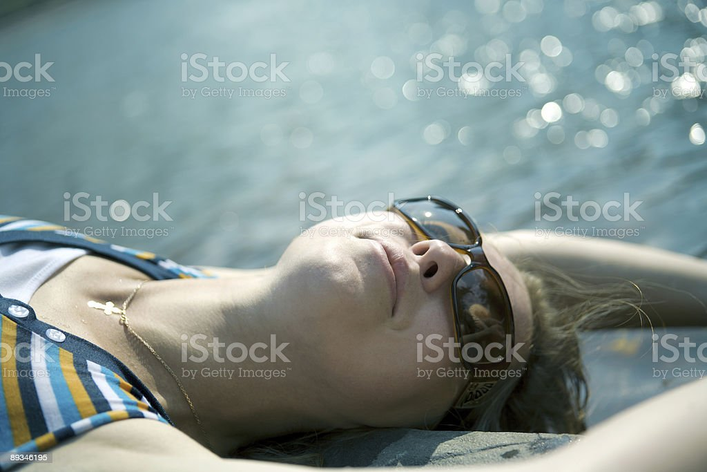 The beautiful girl sunbathes royalty-free stock photo