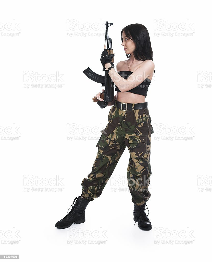 The beautiful girl with a  automatic rifle royalty-free stock photo