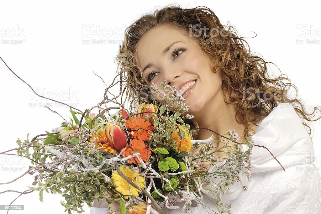 The beautiful girl with a bouquet flowers royalty-free stock photo