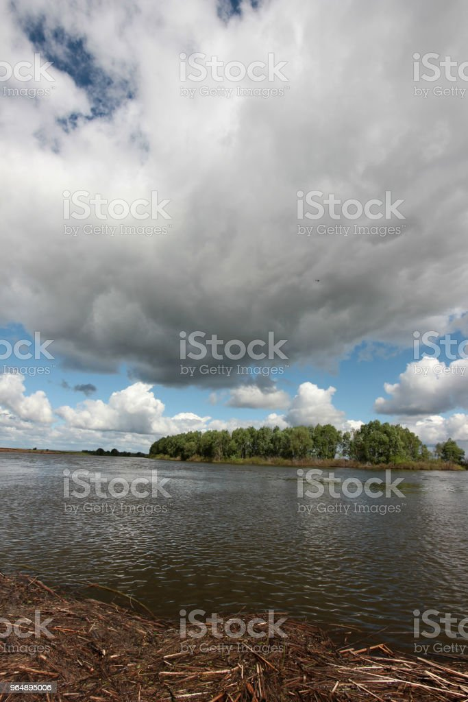 the beautiful landscape with low clouds over the river royalty-free stock photo