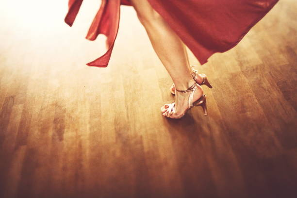 The beautiful legs of a dancing attractive woman stock photo