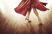 The beautiful legs of a dancing attractive woman