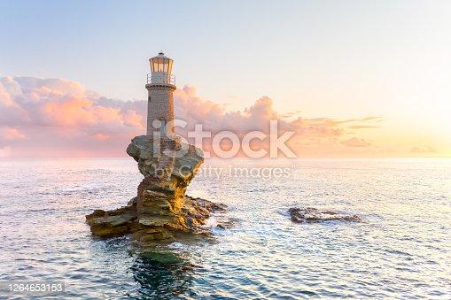 The beautiful Lighthouse Tourlitis of Chora at night. Andros island, Greece