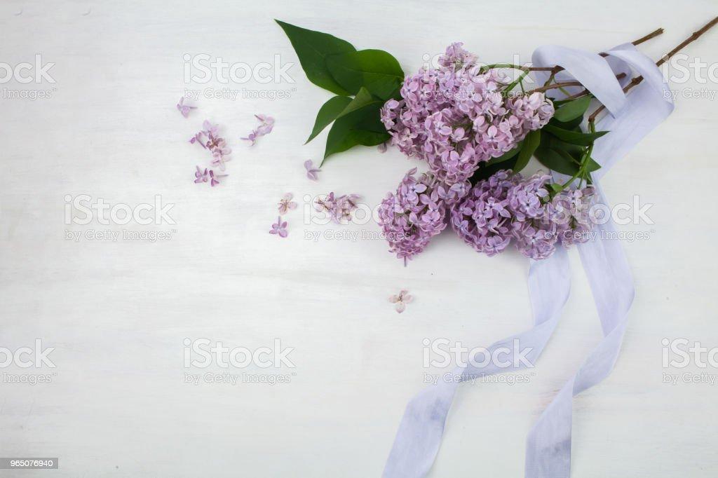 The beautiful lilac on a bright wooden background zbiór zdjęć royalty-free
