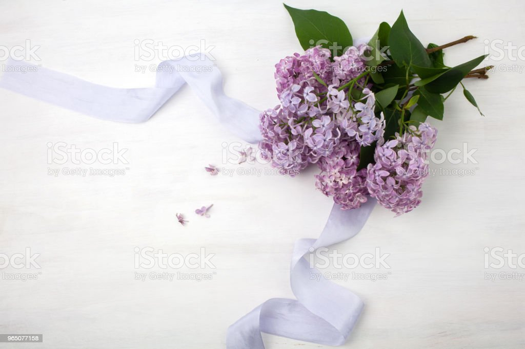 The beautiful lilac on a bright wooden background royalty-free stock photo