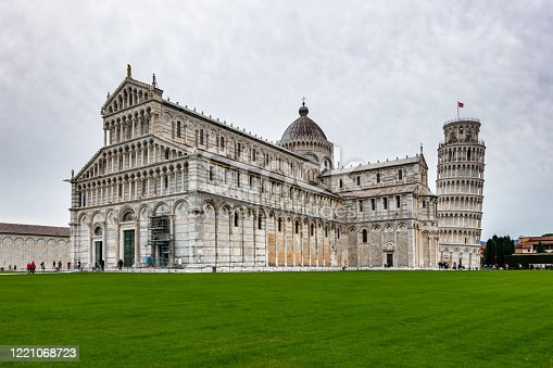 The beautiful Pisa Cathedral, a notable example of Romanesque architecture with the famous  Leaning Tower of Pisa, Tuscany, Italy