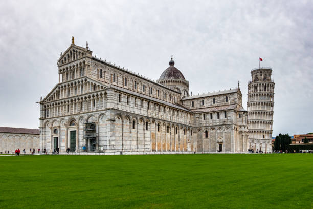 The beautiful Pisa Cathedral, a notable example of Romanesque architecture with the famous  Leaning Tower of Pisa, Tuscany, Italy stock photo