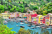 istock The beautiful Portofino with colorful houses, luxury boats and yacht in little bay harbor. A vacation resort with celebrity and artistic visitors. Liguria, Italy ,Europe 1176184038