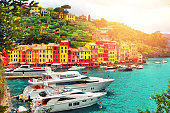 istock The beautiful Portofino with colorfull houses and villas boats and yacht in little bay harbor. Liguria, Italy ,Europe 934696478