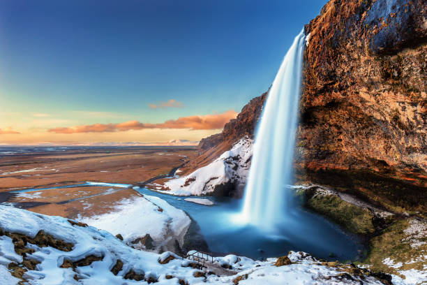 The beautiful Seljalandsfoss in Iceland during winter – zdjęcie