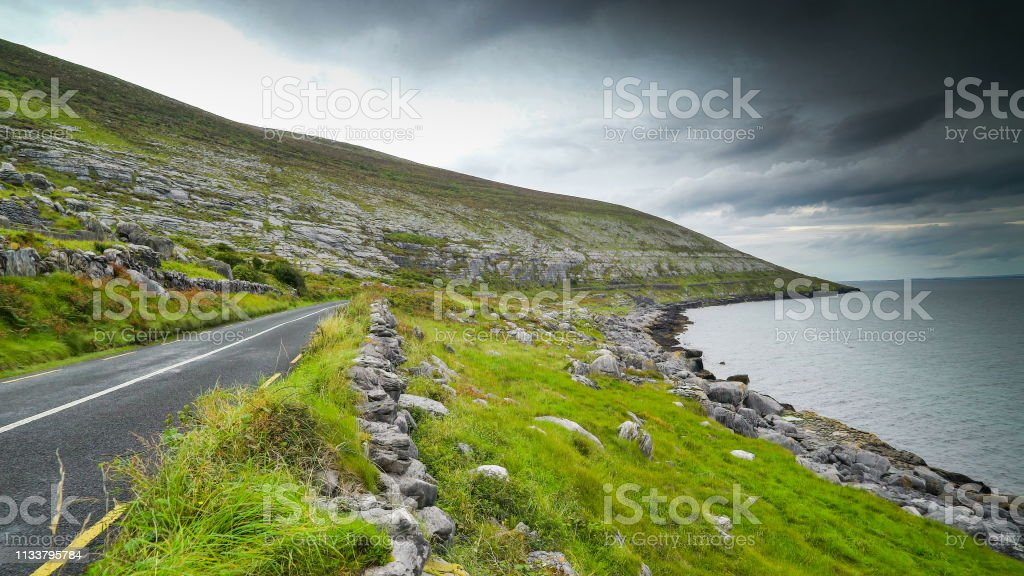 The beautiful shot of the coast in Ireland with the small road...