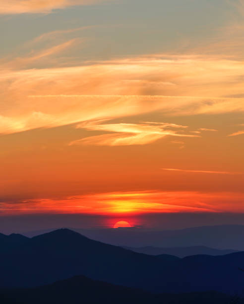 The beautiful sunset in the mountains stock photo