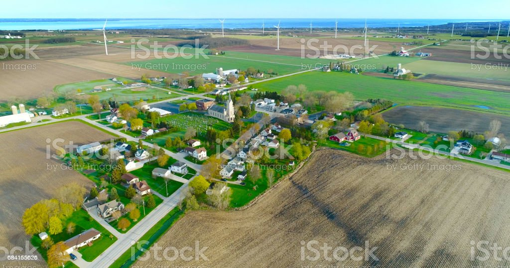 The beautiful town of Johnsburg, Wisconsin nestled in a landscape of giant wind turbines. stock photo