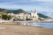 The beautiful town of Sitges, winter Spain, Landscape of the coastline in Sitges, view on the church of Sant Bartomeu and Santa Tecla