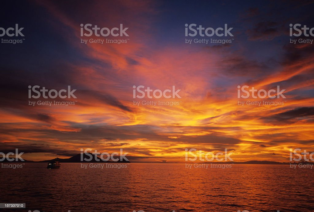 The beautiful warm hues in the sky above a ocean horizon stock photo