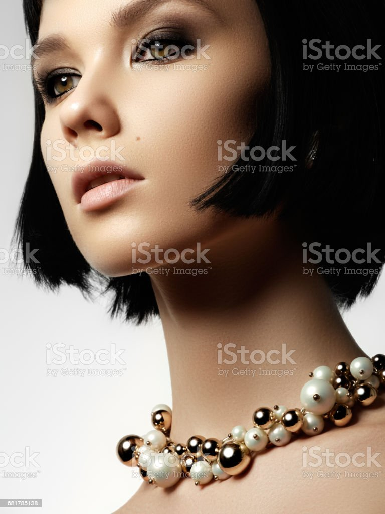The beautiful woman in expensive pendant close-up. Beautiful you stock photo