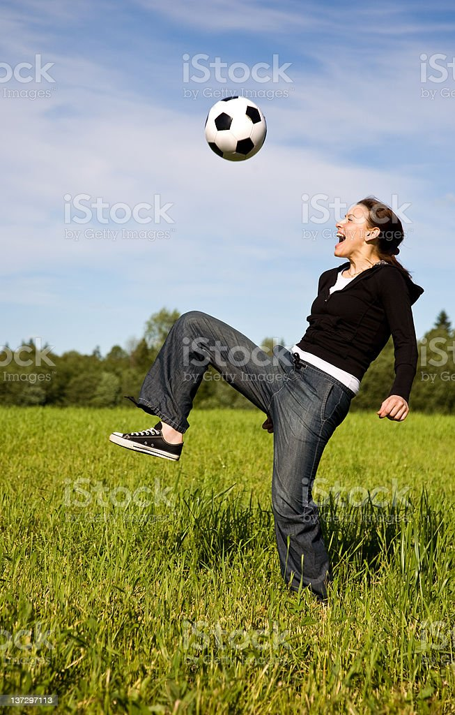 The beautiful woman plays soccer royalty-free stock photo