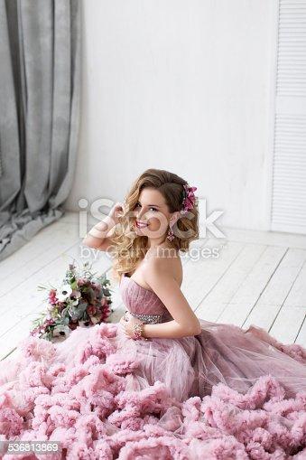 istock The beautiful woman posing in a wedding dress. 536813869