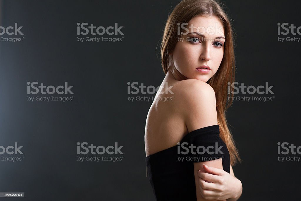 The beautiful woman with a naked back stock photo