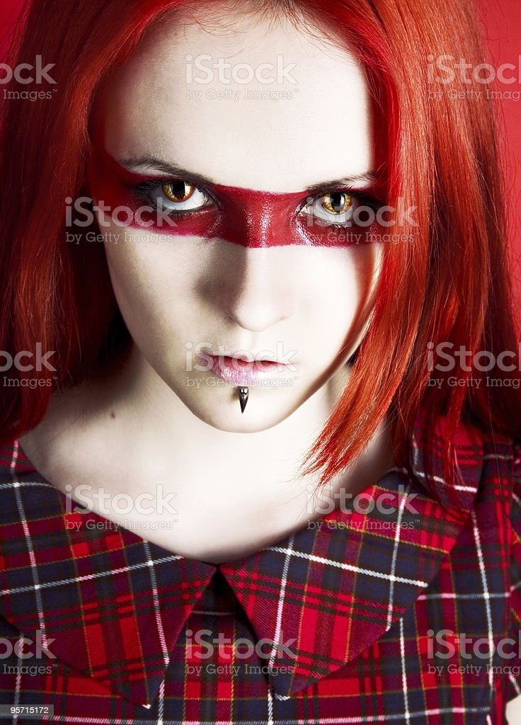 the  beautiful woman with cat's eyes royalty-free stock photo