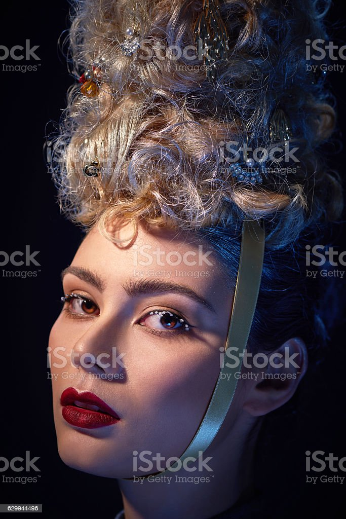 The beautiful woman with Christmas tree hairstyle stock photo