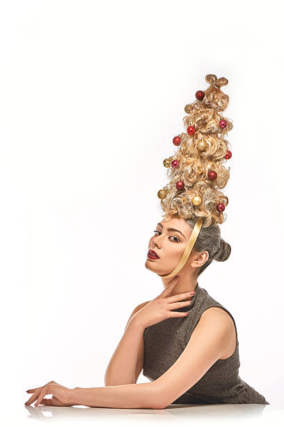 the beautiful woman with christmas tree hairstyle - ohrringe tropfen stock-fotos und bilder