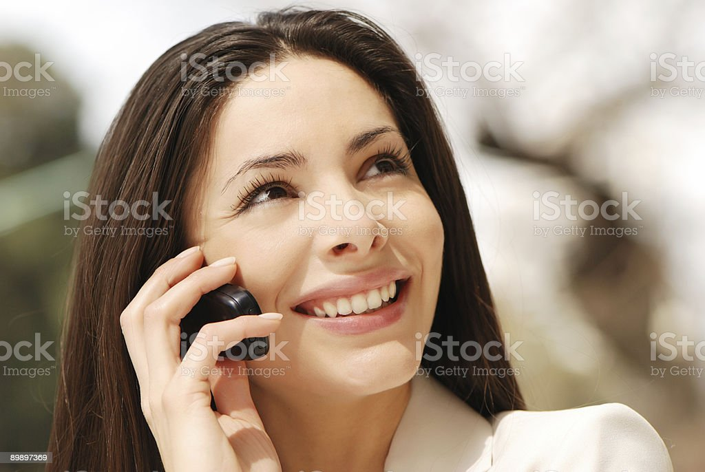 The beautiful young Business woman with Mobile phone royalty-free stock photo
