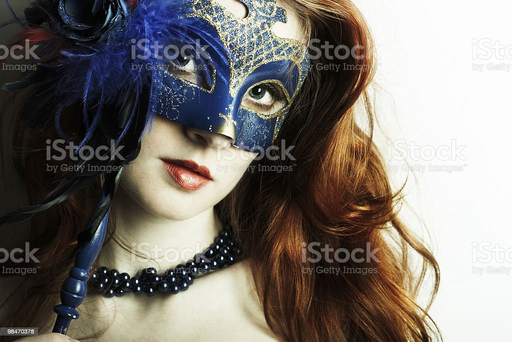 The beautiful young girl in a mask royalty-free stock photo