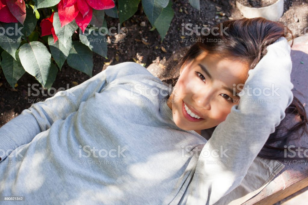 the beauty asian relaxe in the park stock photo